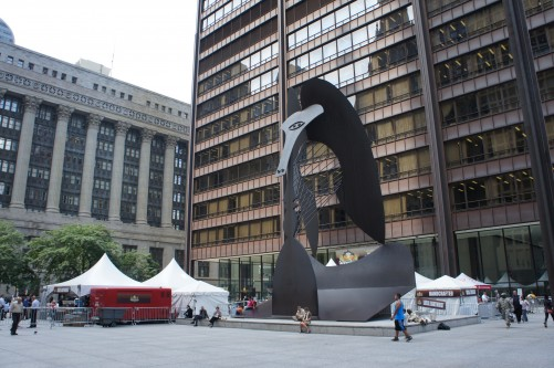 Daley Plaza's famed Picasso sculpture looms over the Wurst Festival's tents