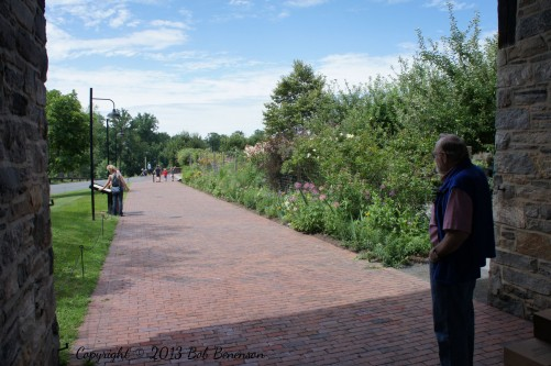 Fred Kirschenmann, president of the Stone Barns Center, surveys the gardens near the eponymous buildings.