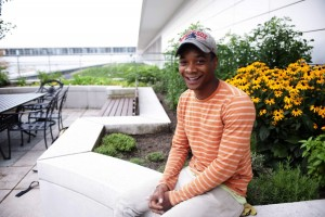Darius Jones, the coordinator of the rooftop farm at Chicago's McCormick Place convention center, had a troubled youth that he turned against by engaging in urban agriculture. Photo by Paul Natkin, courtesy of Farm Aid.