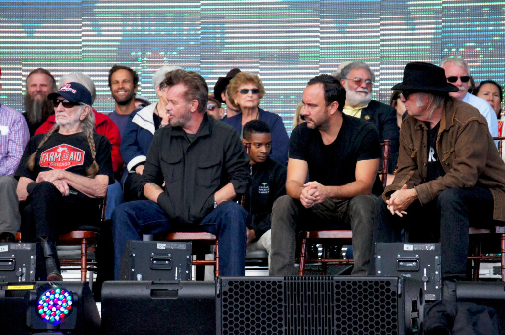 Darius Jones, the coordinator of the rooftop farm at Chicago's McCormick Place convention center, had a place of honor on the stage during the star-studded news conference that preceded the Farm Aid concert in the city Sept. 19. That's him in the front row of an invited group of farm advocates, between artists John Mellencamp and Dave Matthews, who are flanked by fellow Farm Aid members Willie Nelson (left) and Neil Young (right). Photo by Bob Benenson/FamilyFarmed