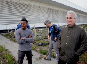 Darius Jones (left), coordinator of the rooftop farm at Chicago's McCormick Place convention center, during a FamilyFarmed staff visit in October 2014. FamilyFarmed President Jim Slama is on the right. Photo by Bob Benenson/FamilyFarmed.