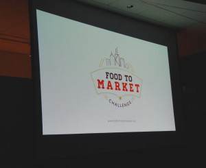 The Food to Market Challenge logo was projected at a Chicago event held Jan. 27 to launch the project.