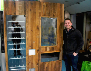Luke Saunders is the founder and owner of Farmer's Fridge, whose growing three-year-old Chicago business sells fresh salads in jars from vending machines. Here he shows off a new model vending machine that the company is installing at its sites.