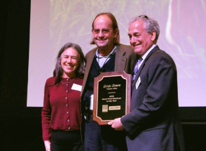 FamilyFarmed President Jim Slama (right) presented Organic Valley CEO George Siemon and Mission Executive Theresa Marquez with FamilyFarmed's Good Food Business of the Year Award at the Good Food Financing & Innovation Conference in Chicago March 24. The event took up the first day of FamilyFarmed's three-day, 12th annual Good Food Festival & Conference.