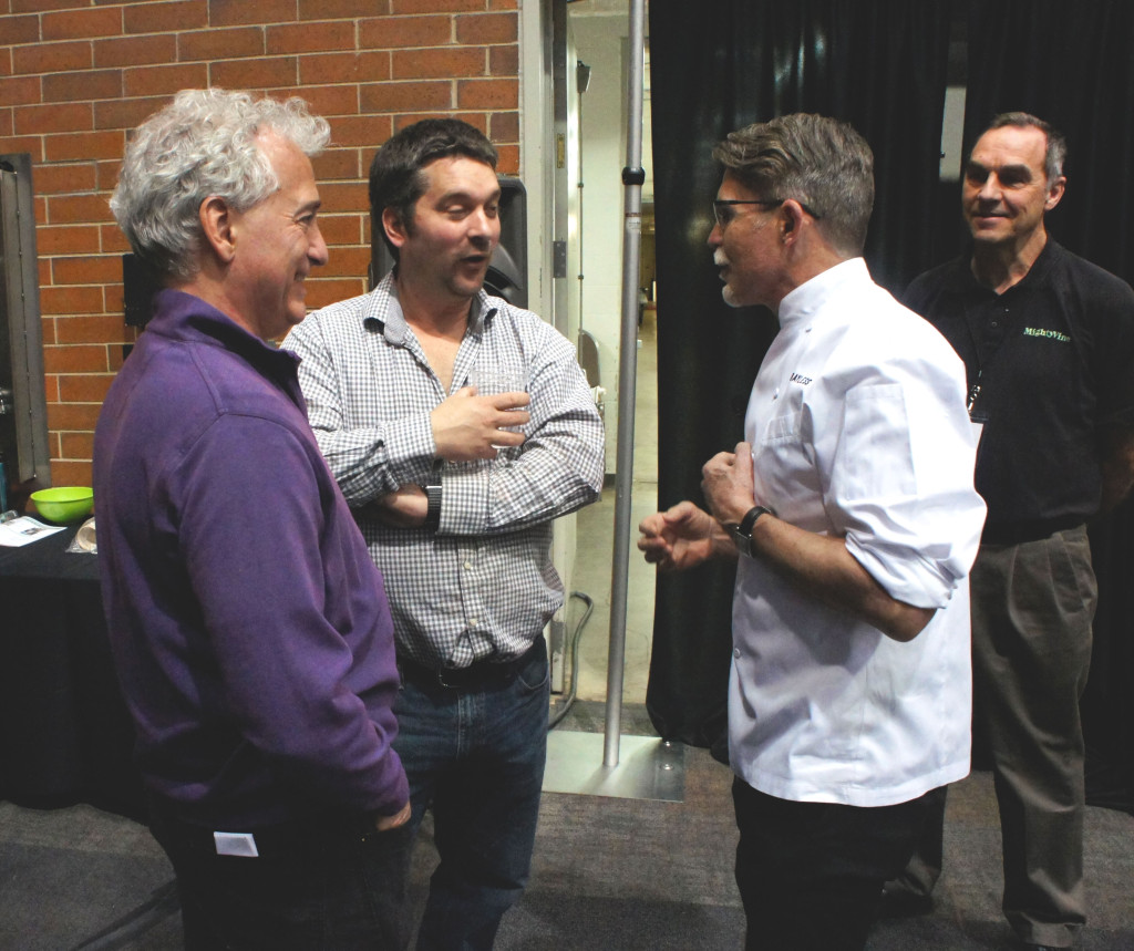 Leading figures in the Chicago region's Good Food sector chatted before the Chefs at Play demos at the Good Food Festival kicked off. From right, celebrated chef Rick Bayless; Greg Gunthorp, a sustainable livestock producer in Indiana, who supplies much of the pork and poultry for Bayless' restaurants; and FamilyFarmed President Jim Slama. Watching at right is Nic Helderman, chief operating officer for Mighty Vine, an indoor tomato producer that has made a big impact on the Chicago market for the quality of its products since it opened last year.