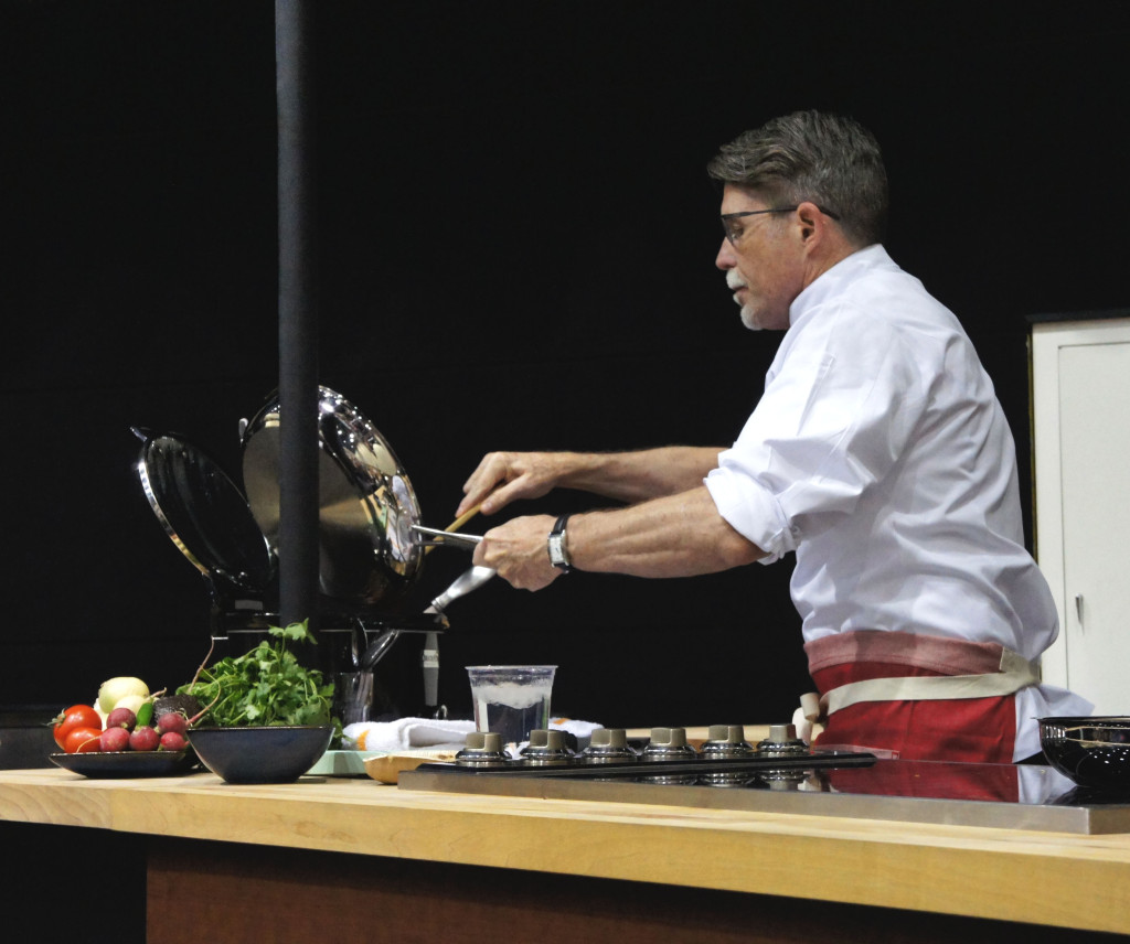 Bayless added his fresh tomato sauce to his slow-cooker pork and black beans preparation at his Good Food Festival demo.