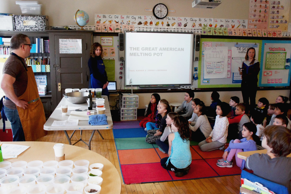Chef Paul Kahan and One Off Hospitality Group colleague Jenna Liberman (blue apron) taught a 2nd grade class on the impact of immigration on how Americans eat during a Pilot Light day at Chicago's Disney II magnet school on Feb. 29.