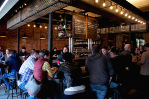 The busy bar at Forbidden Root's brewpub in Chicago. All the beers listed on the chalkboard at the city's first botanical brewery are made in-house.