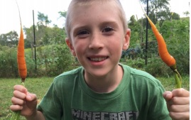 Aidan was a carrot-loving camper during Nature's Farm Camp's first year in 2015.