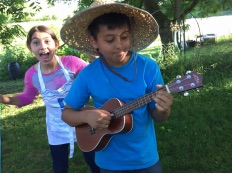 Child farmer/cooks warmed up for the talent show at the 2015 Nature's Farm Camp.