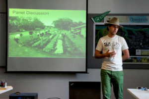 Justin Vandebroeck, a Fleet Farming coordinator in Oakland, California, explains the company's urban farming concept at a meeting of Good Food advocates in Chicago Aug. 2. Photo by Bob Benenson/Family Farmed.