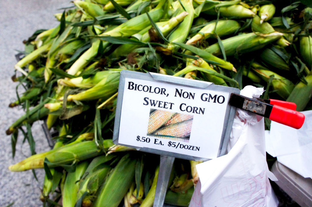 The sweet corn at Chicago's farmers markets this year is abundant and accessibly priced. The Smits Farm stand at downtown's Federal Plaza is a good example of the benefits of buying seasonally and buying in bulk. Photo by Bob Benenson/FamilyFarmed
