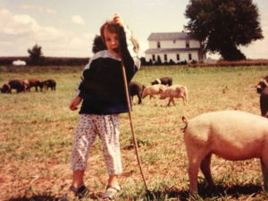 Kara Gunthrop shared this photo of her hanging with the hogs when she was a little girl. She says that she and her siblings helped take of the chickens on the farm from a very young age.