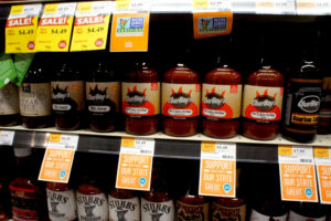 Locally made products are prominently labeled on the shelves of the Whole Foods store.