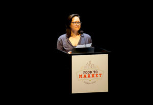 Monica Eng of WBEZ Chicago Public Radio, one of the city's leading food journalist, emceed the Food to Market Challenge pitch and award event.